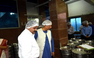 Prof. Yunus carefully watching the sterilised vessels for packing the cooked meals