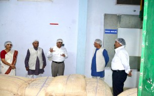 Sridhar explaining matters on storage and handling to the dignitaries