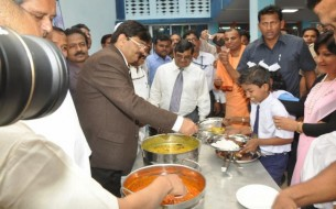 Dignitaries Share In Serving The Mid Day Meal To Happy Students